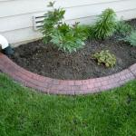 red cobblestone brick flower bed